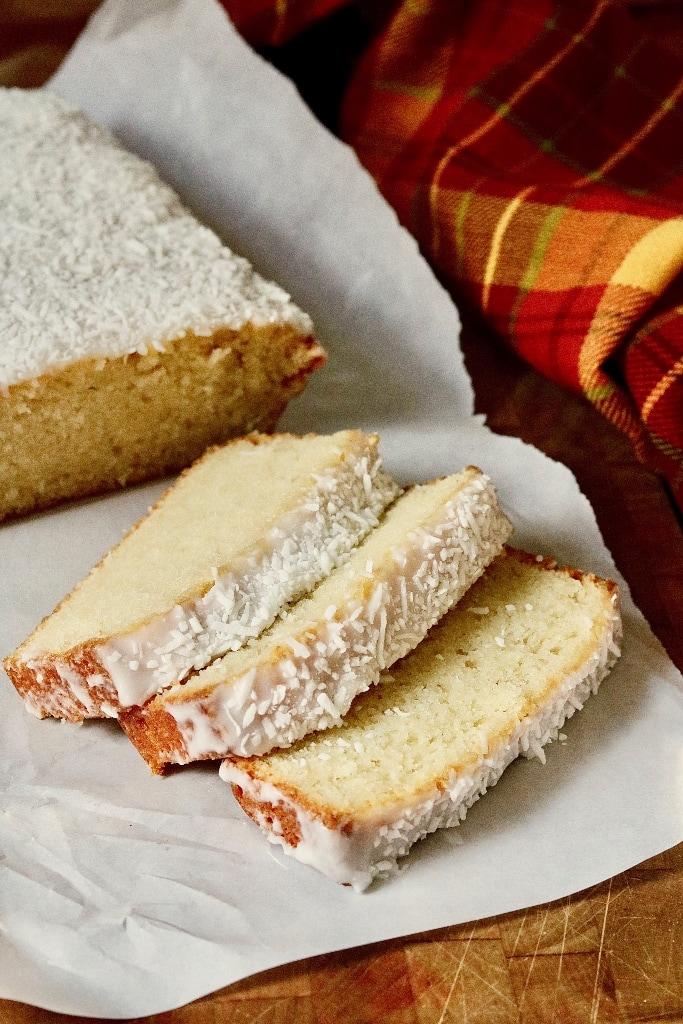 vegan coconut loaf cake sliced on parchment paper
