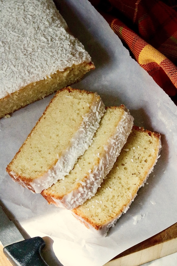 three slices of coconut loaf on parchment paper
