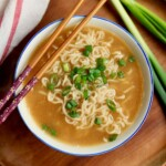 ramen soup in a bowl with chopsticks
