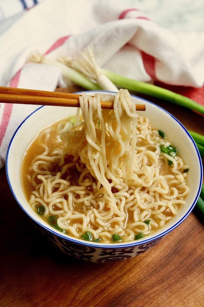 ramen soup being eaten with chopsticks
