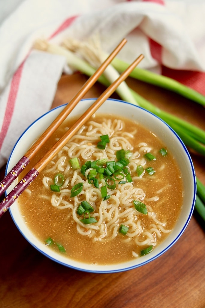 ramen soup with chopsticks on top of bowl