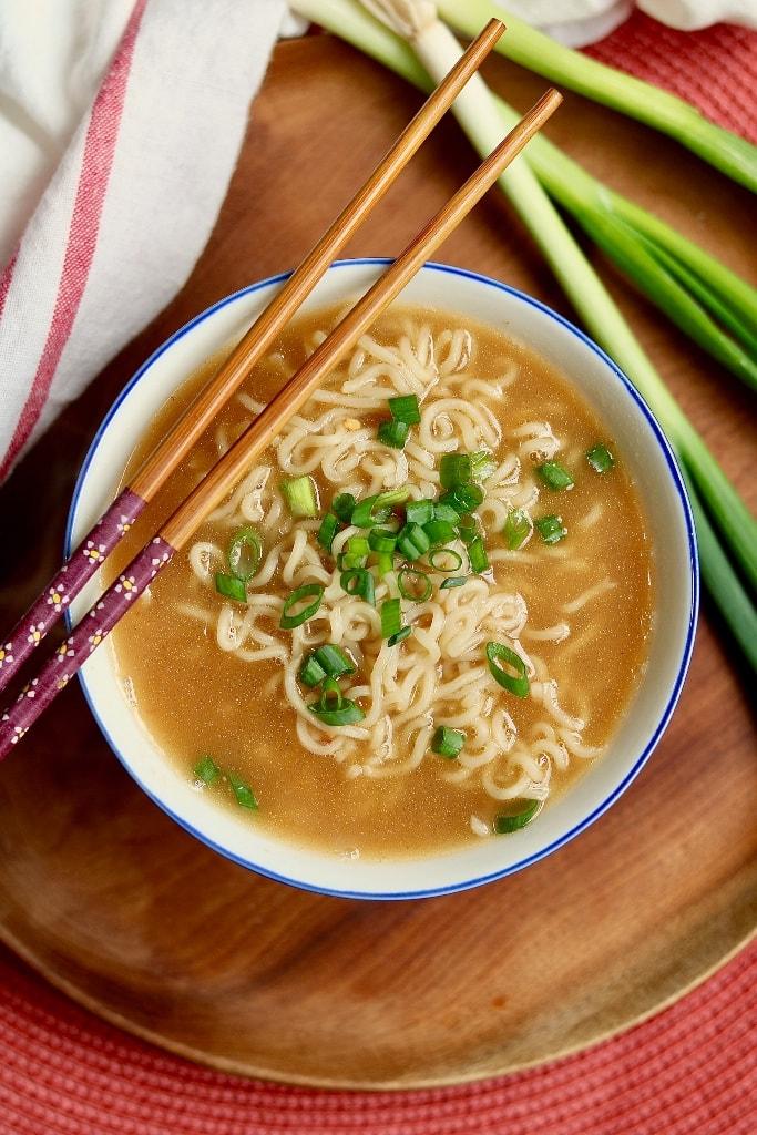 vegan ramen in a white bowl with chopsticks