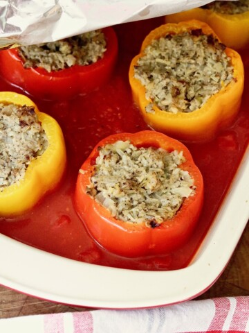 vegan stuffed peppers baked in a casserole dish