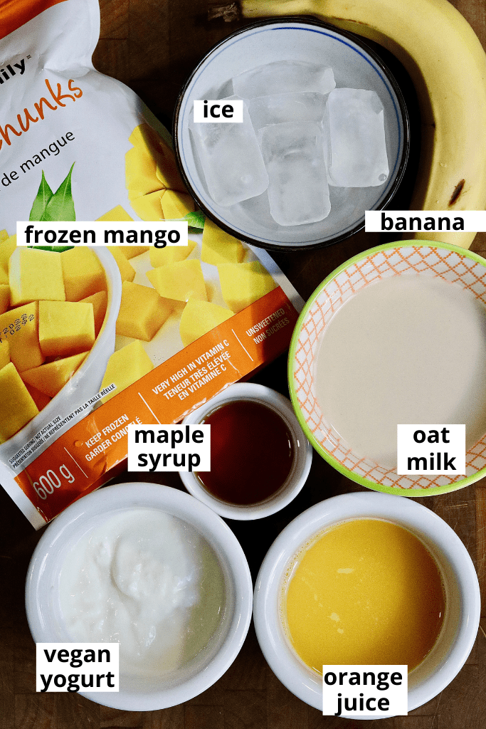 photo of all ingredients for mango smoothie on counter