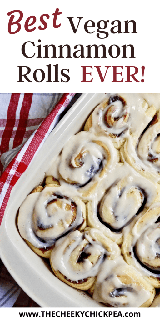 vegan cinnamon rolls baked and frosted in a pan