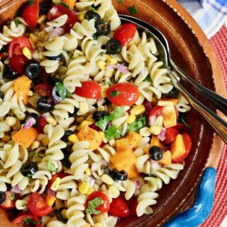 vegan pasta salad ready to serve in a salad bowl