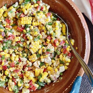 mexican street corn salad mixed in a bowl