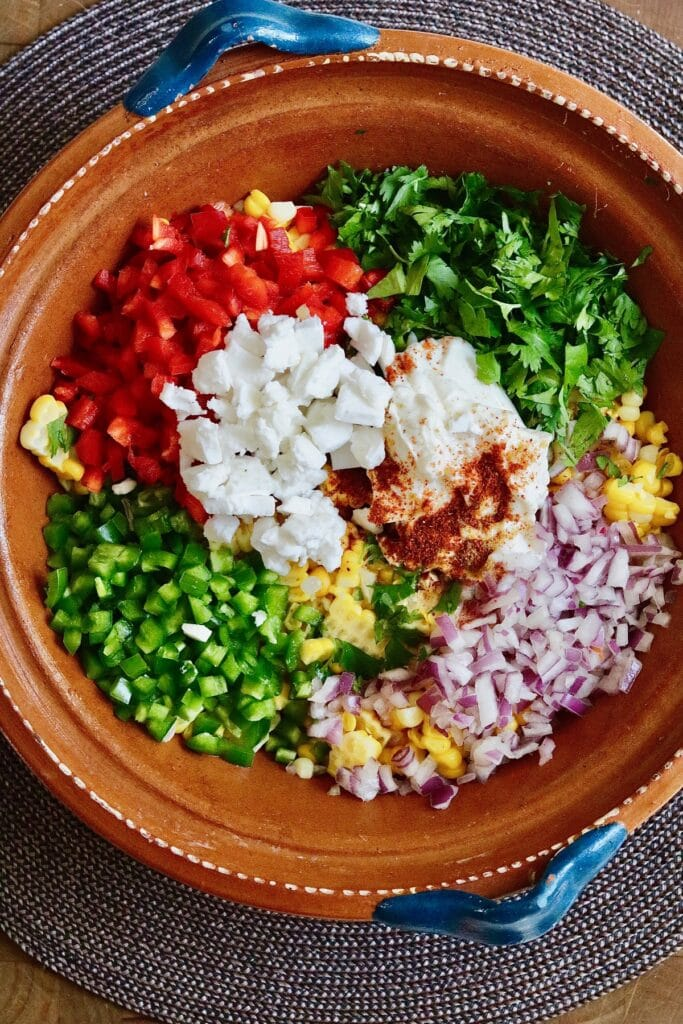 ingredients for mexican corn salad in a bowl
