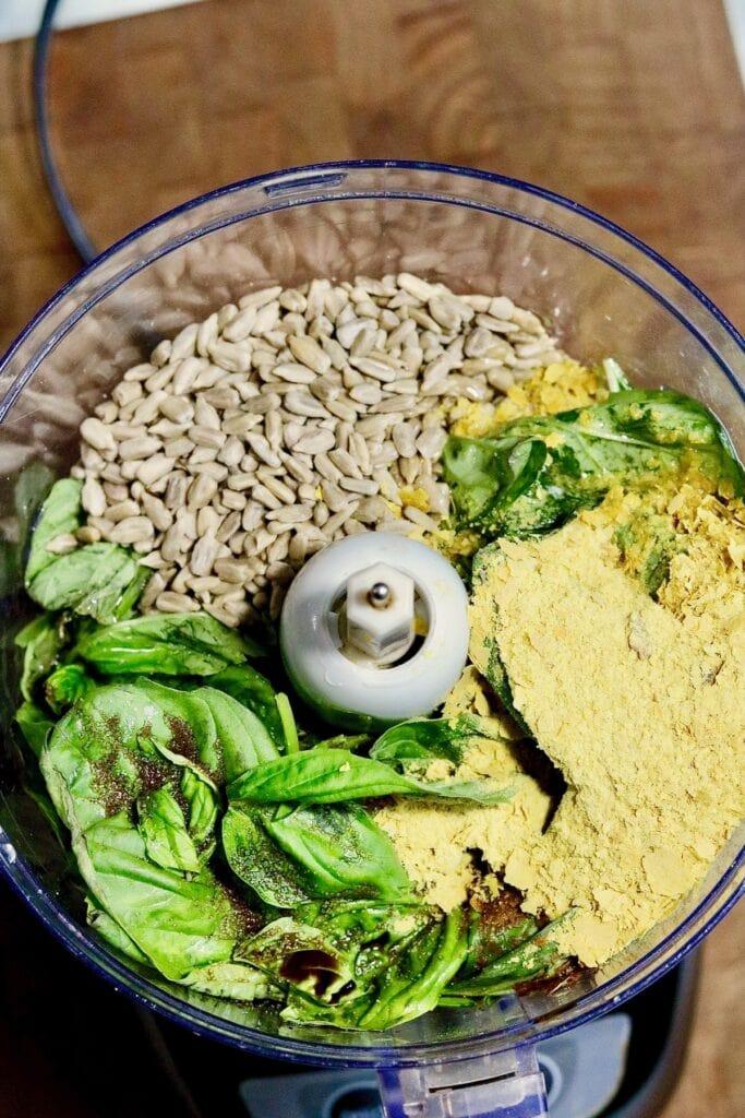 vegan pesto ingredients in a food processor