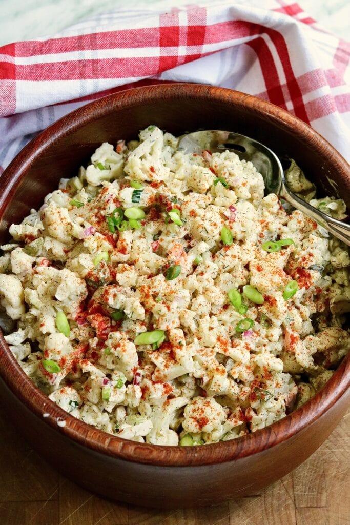 cauliflower potato salad ready to serve in salad bowl