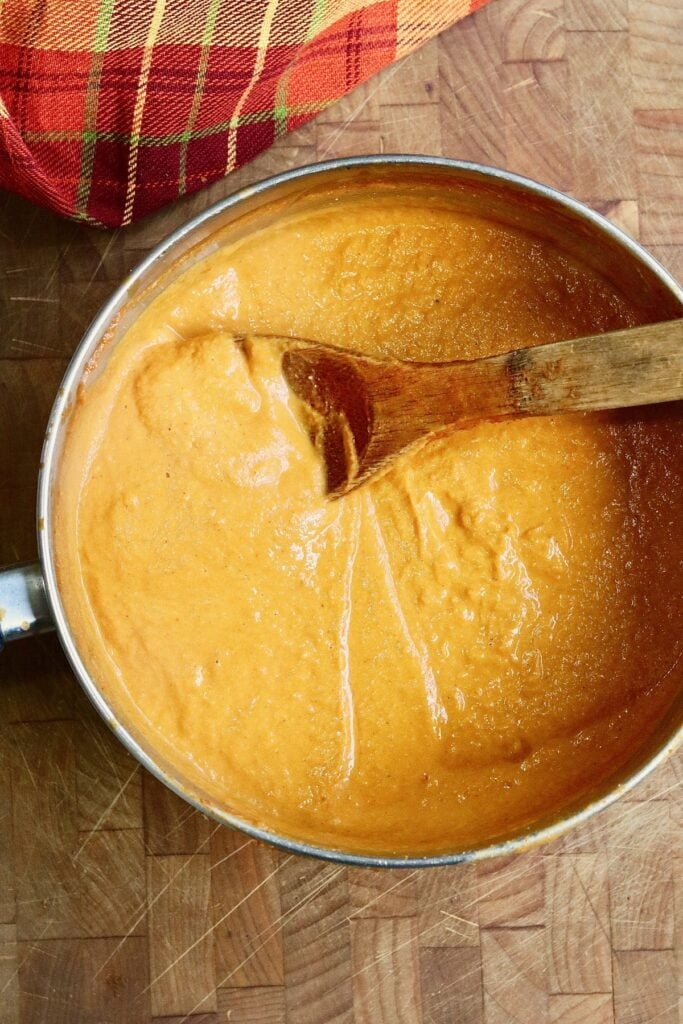 pumpkin pasta sauce ingredients blended and cooked in a pan